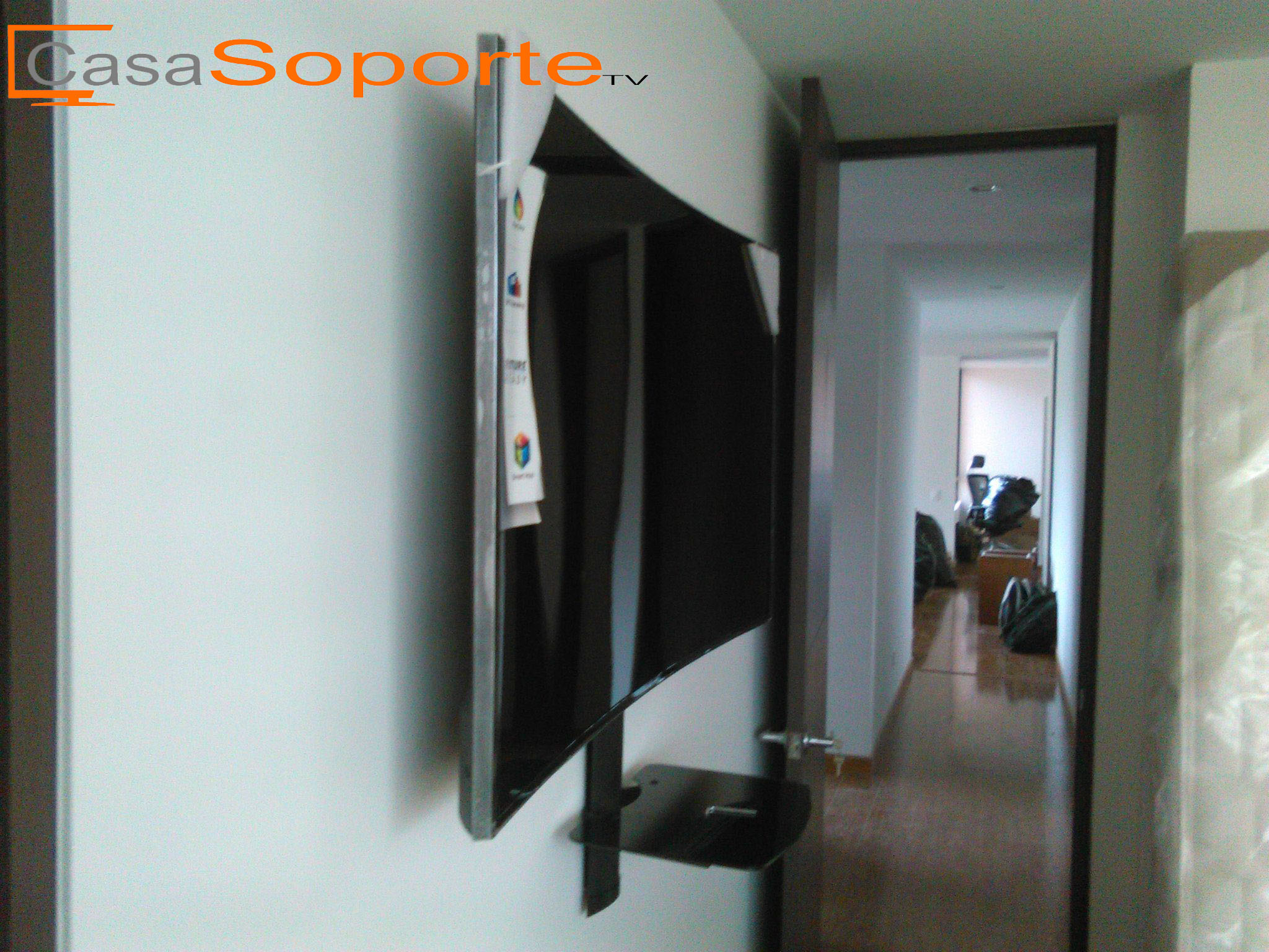 Instalacion de soporte de tv curvo for Televisores en la pared